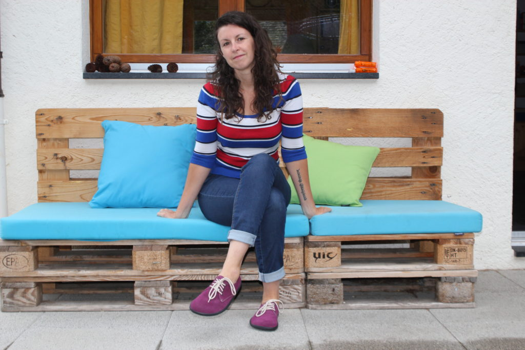 Woman sitting outside wearing Belenka plum shoes