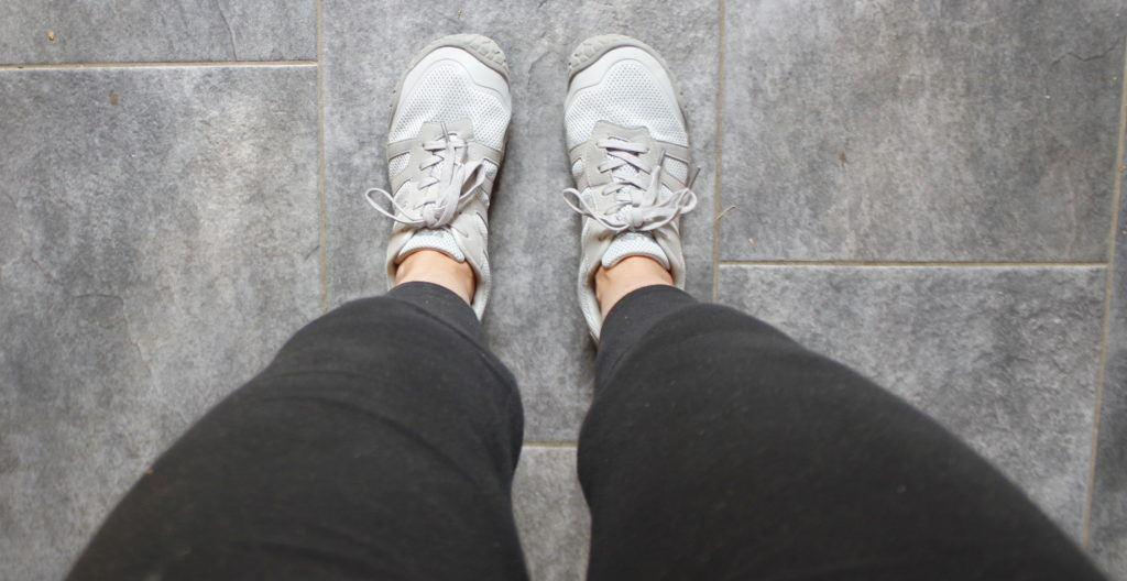 looing down barefoot sneaker