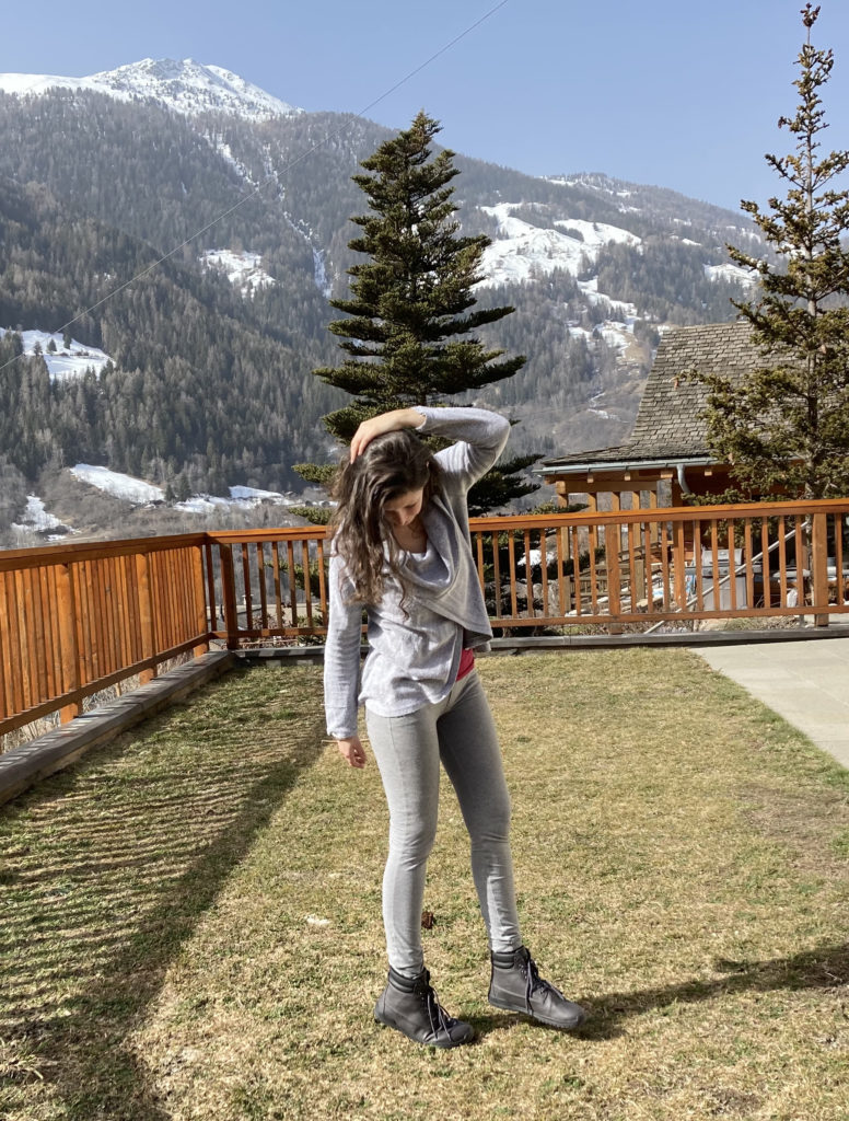 woman in alps wearing winter boots