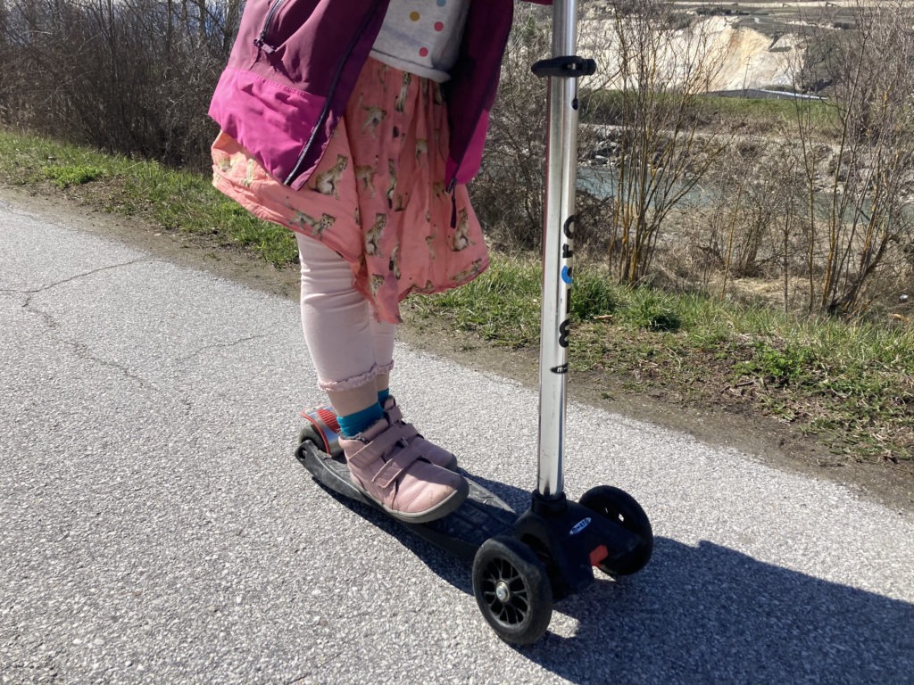 girl on micro scooter