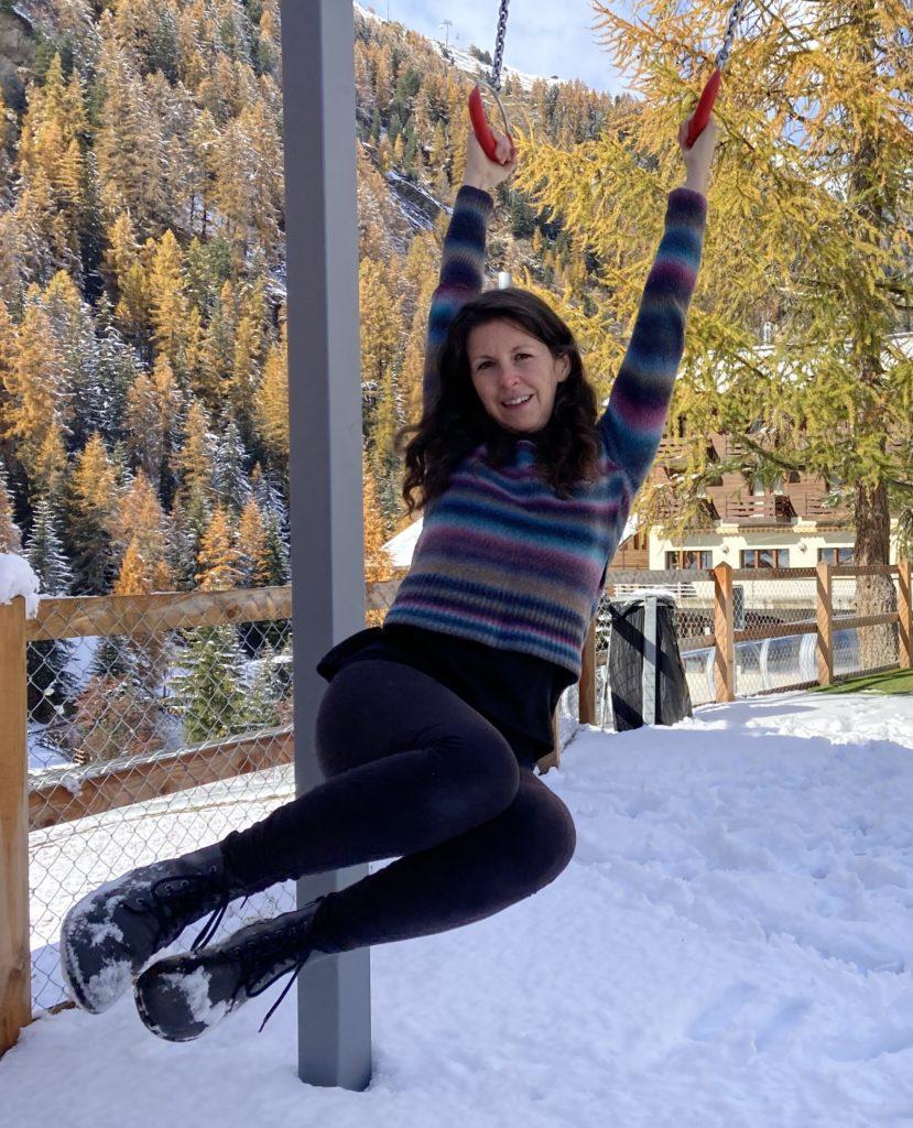 Girl swinging wearing Belenka Boots